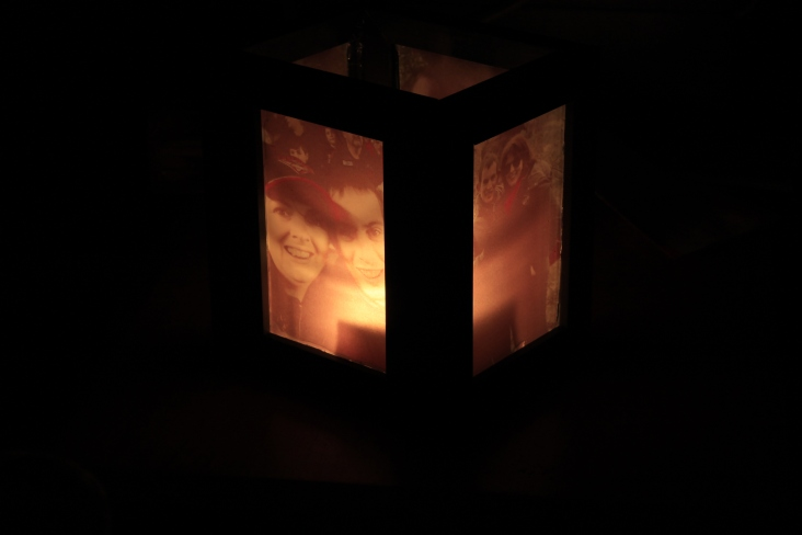 very, very easy DIY...vellum printed photos attached with a flameless andle on the inside to light up the pictures.